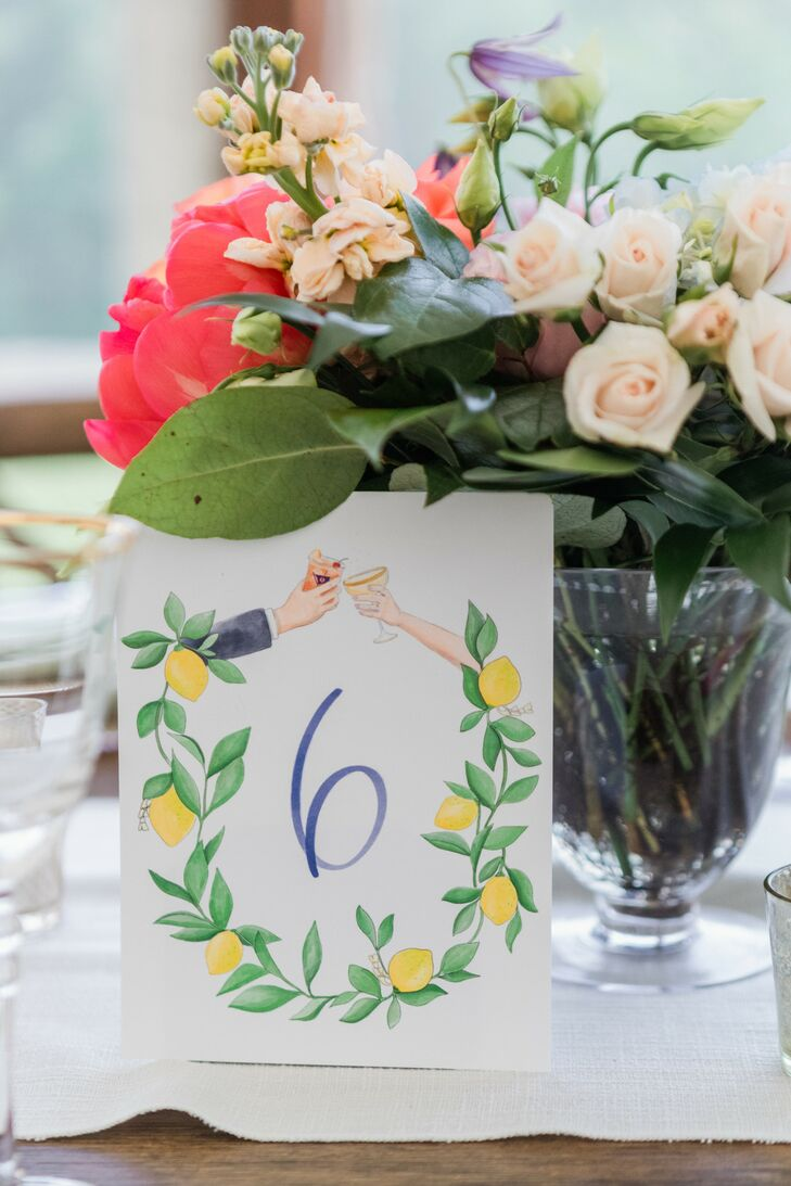 Whimsical Colorful Table Numbers and Flower Centerpiece