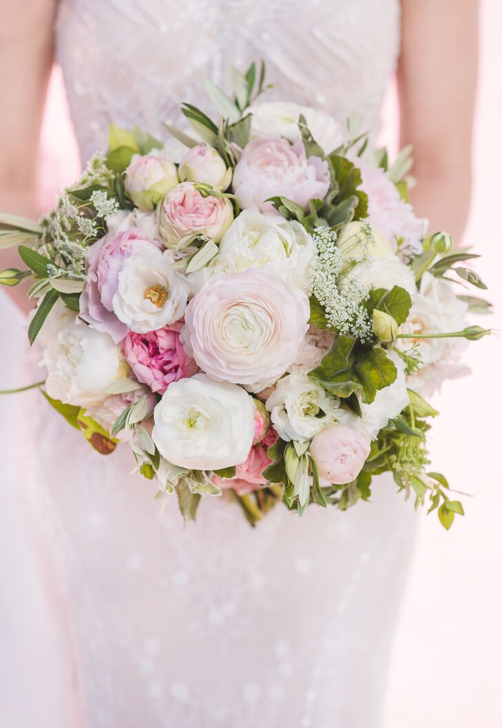 Florist Layers of Lovely crafted a lush blush pink and ivory bouquet with plenty of roses and touches of greenery.