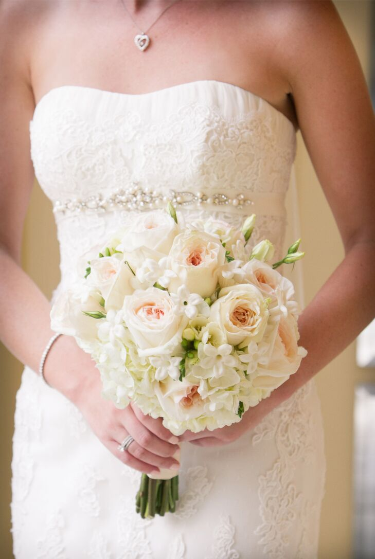 """Lauren carried an understated bouquet of blush roses and white freesia. """"The blush color of the roses matched the detailing on my gown,"""" she explains."""