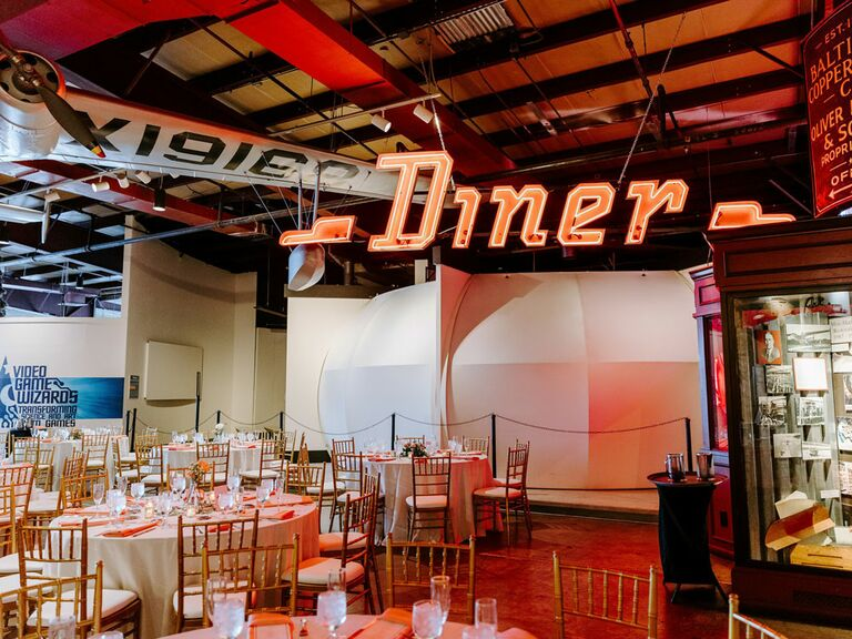 Retro-themed wedding reception with neon Diner sign