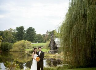 Dana and Alex used a bright color palette of orange and gold to complement the late September foliage.