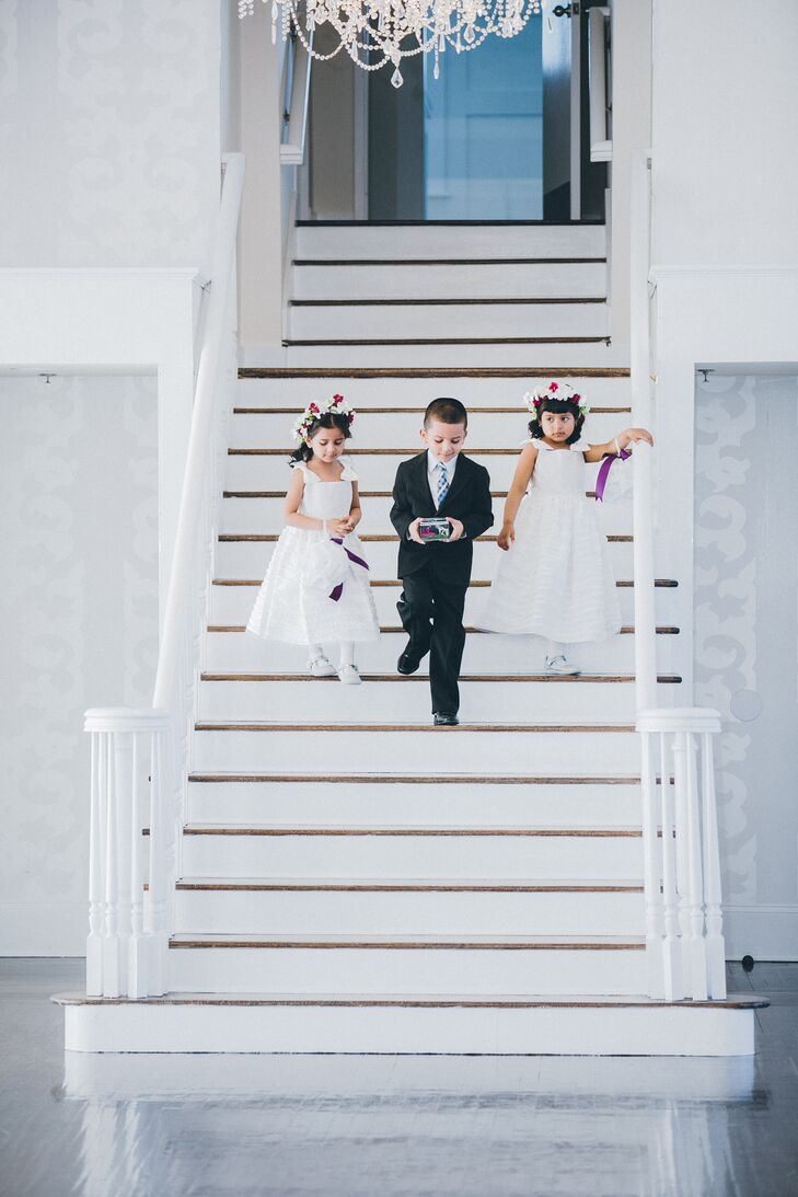 The groom's young sister, niece, and nephew kicked off the ceremony with an entrance down the white staircase.
