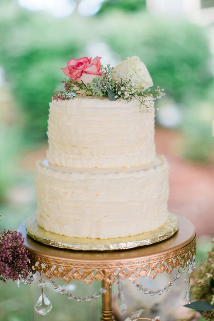 In addition to this ruffled buttercream cake, the newlyweds served naked cakes, cupcakes and strawberry-infused vodka displayed in miniature corked glass bottles.
