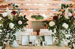 Vintage Table for Remembering Loved Ones with Flower Arrangements