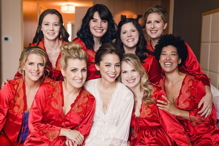 "In China, the bride traditionally wears red. Nicole tried to incorporate the color in other ways, including silk robes from China as bridesmaid gifts and red bridesmaid dresses. The color ""symbolizes good luck, love, prosperity and happiness,"" she says."