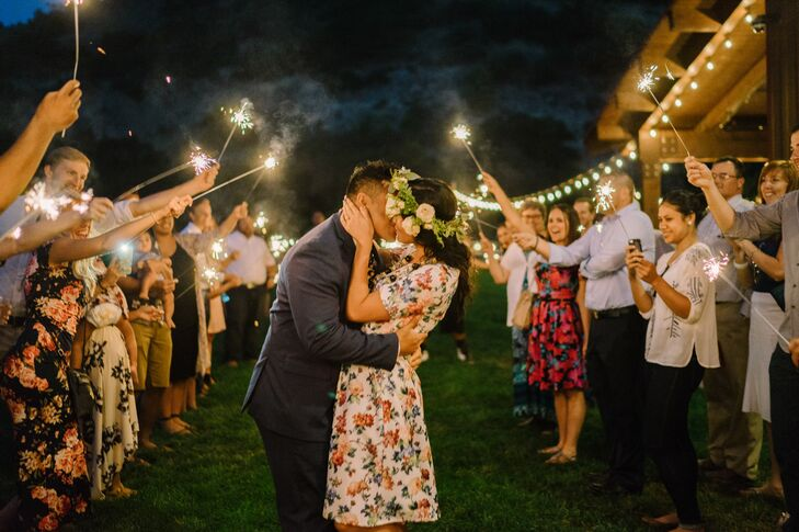 """At the end of the night, the newlyweds exited through a sparkler tunnel. Kourtney's advice for other brides is simple: """"Make it yours, even if what you like isn't trendy. And enjoy every second of the day—you deserve it after all those crazy months of planning."""""""