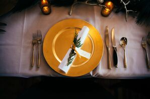 Pine- and Gold-Ribbon-Adorned Place Settings