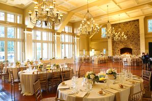 Neutral Ceremony Decor With Amber Uplighting