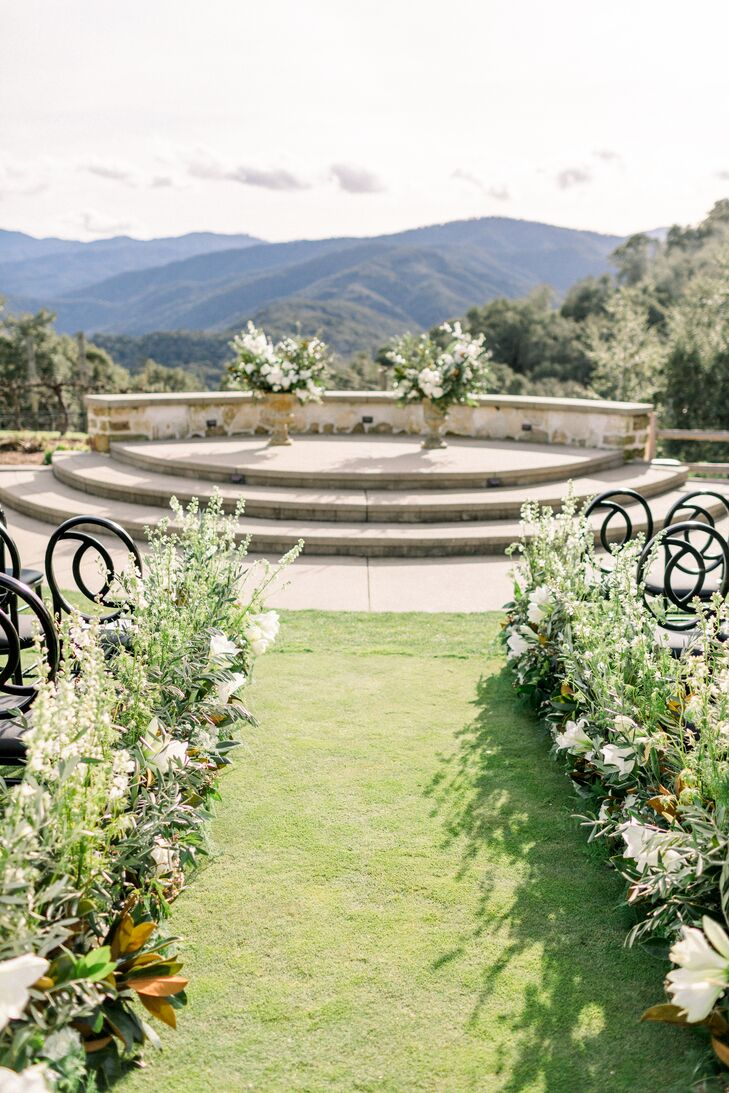 Ceremony Site with Flower Arrangements and Mountain View