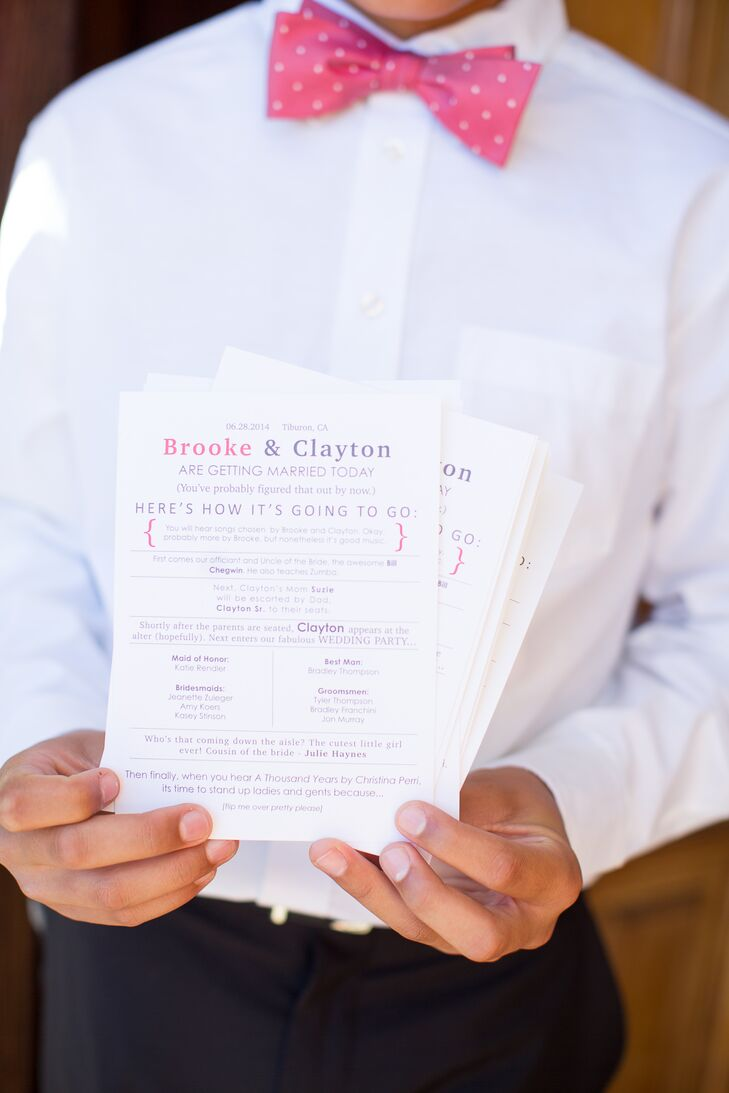 As guests entered the ceremony space, they received white programs with purple and pink text that listed the wedding party. The classic stationery incorporated subtle touches of color, which tied into the wedding's colors.