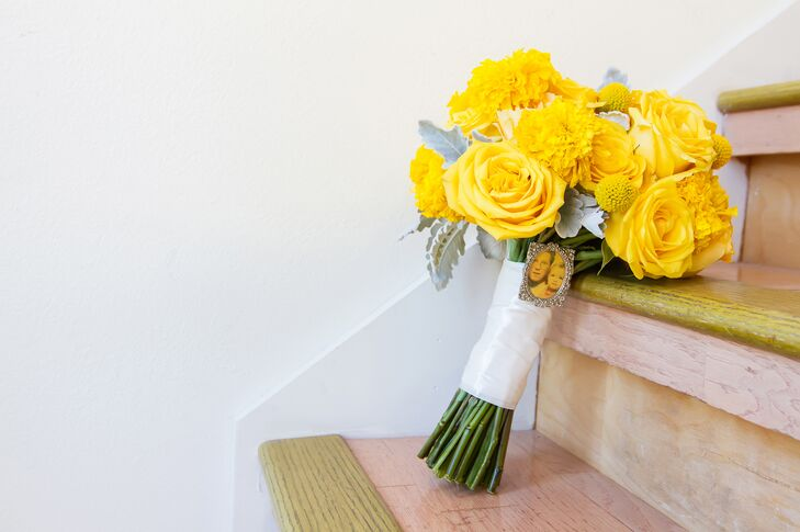 The bride's favorite color is bright yellow, so she carried a bouquet of yellow roses and marigolds with dusty miller.