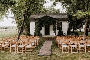 Casual Bohemian Backyard Ceremony with Rug, Folding Chairs and Greenery Arch