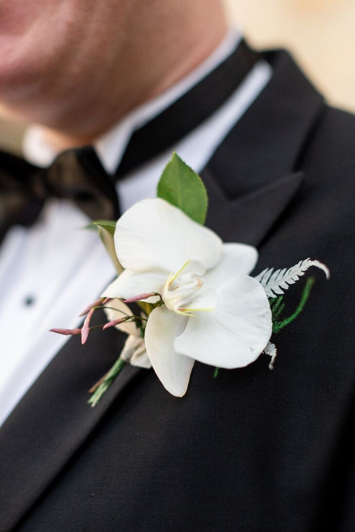 Classic White Orchid Boutonniere