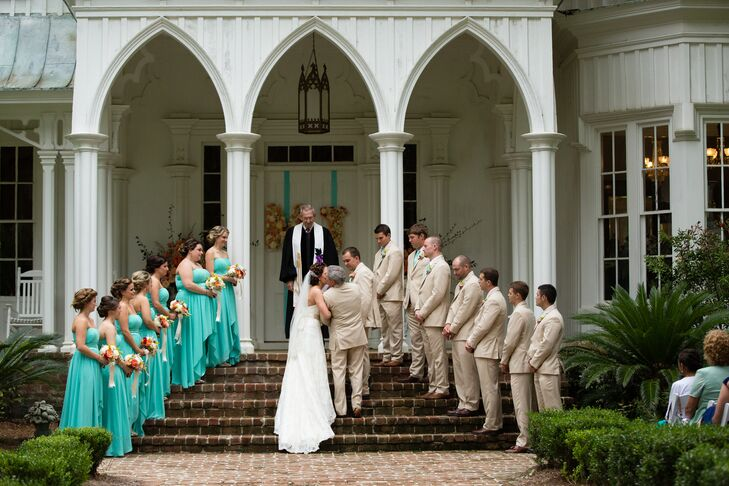 Madeline knew she wanted her bridesmaids in high-low dresses for the destination wedding at Rose Hill Mansion in Bluffton, South Carolina. She found bright, bold teal dresses by Bari Jay that were absolutely perfect. The groomsmen wore casual khaki suits from Lord West to fit the semi-casual, chic wedding.