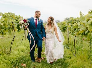 Brianna Wood and Jason Springs pulled off a glam bohemian bash for their mid-summer wedding at an Indianapolis vineyard. Wild, organic florals with lo