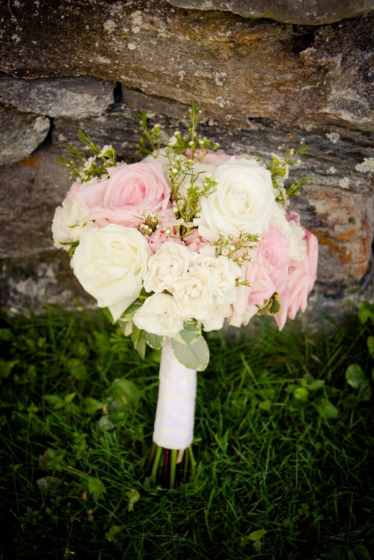 Pastel pink and white roses made up the romantic bridal bouquet. Sprigs of Baby's Breath completed the soft look.