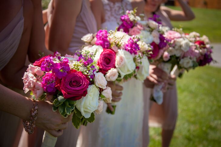 The bridesmaids carried romantic rose bouquets with bright fuchsia, cream and pastel pink roses.