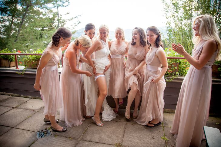The bridesmaids wore blush colored flowing gowns. They walked down the aisle barefoot, like Sarah.