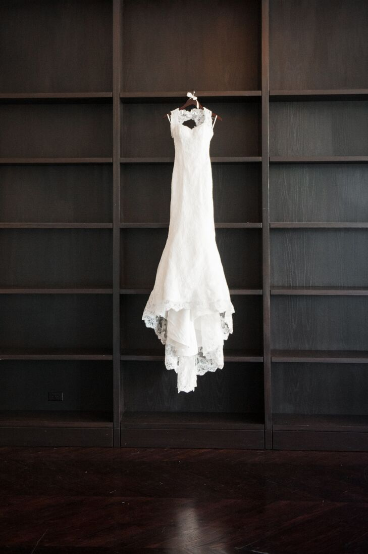 The bride wore a classic, white dress by Marisa with simple sleeves and a lace detail.