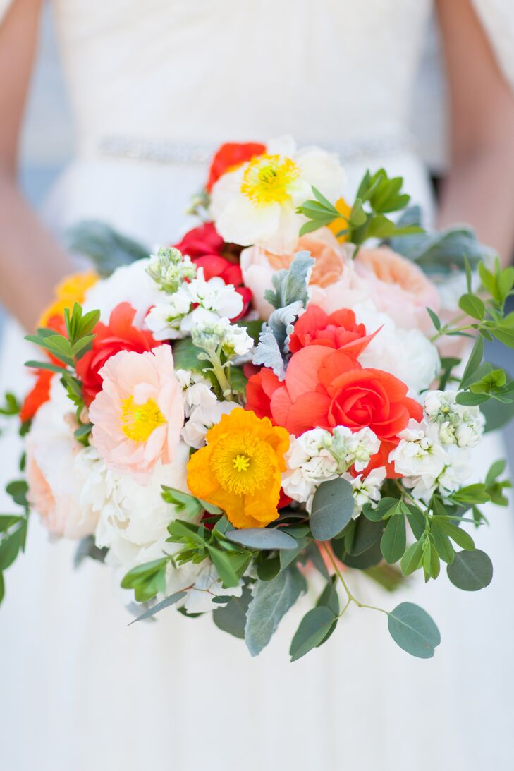 The bride chose bright, cheerful colors in peach, coral and yellows accented with mint. Not only are these her favorite colors, they just so happen to be the colors that her favorite flowers, Icelandic Poppies, bloom in.