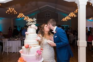 Couple Cutting Into Bright Cake at Reception