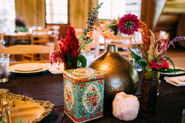 "In order to achieve their eclectic and natural wedding style, the couple mixed DIY items with a rich jewel-tone color palette. ""The tables were either draped in chocolate brown linens or kept exposed with natural wood and different colored vases full of flowers with hints of brass tying everything together,"" says Pattie."