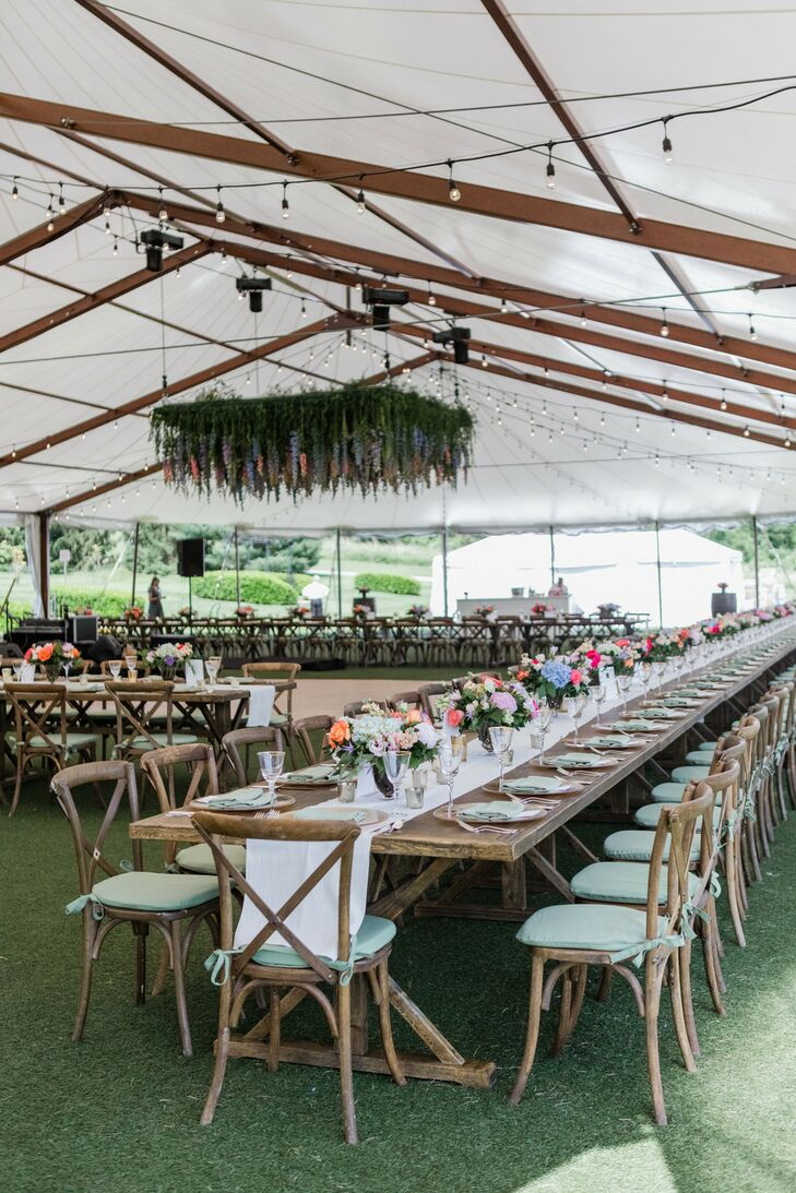 Modern Tented Reception with Long Farm Tables and Hanging Arrangement