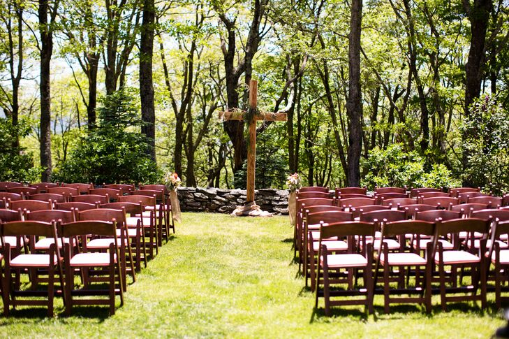 Outdoor enthusiasts, Anna and Elliot chose an outdoor ceremony on the lawn at Twickenham Estate speaking their vows in front of a cypress wood cross that Anna's father made.