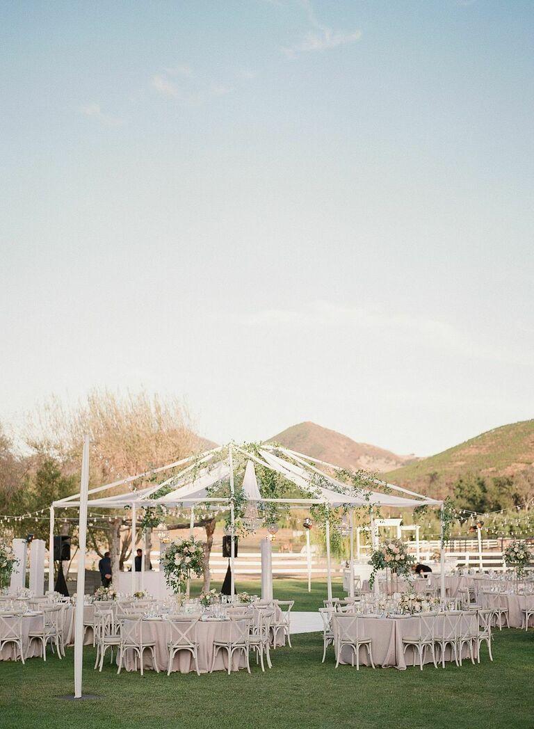 Alfresco wedding reception with draping