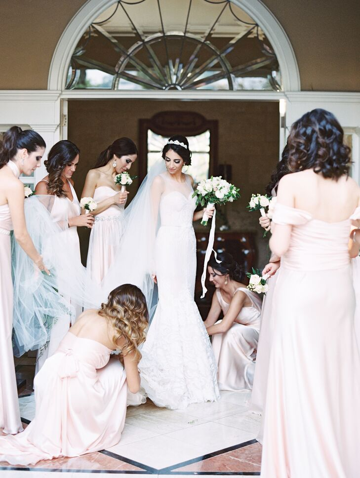 "Early in the planning process, Monique gave her bridesmaids a special gift box. ""I gave my bridesmaids a blush pink fabric, which I wanted them to use to make their dresses in their preferred styles,"" she says."