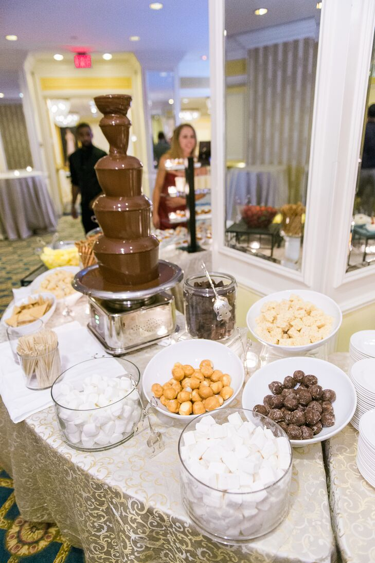 Jackie and Donovan provided their guests with tons of desserts at the reception. This included a chocolate fondue fountain with fruits, donut holes, marshmallows and pretzels for dipping.