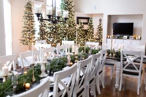 Simple White Reception with Greenery, Candles and Lit Christmas Trees