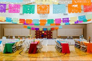 Eclectic Reception with Colorful Linens and Hanging Papel Picado Flags