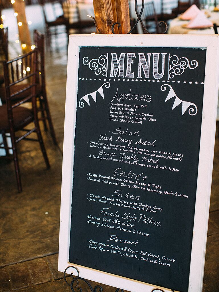 Wedding chalkboard sign with hand-lettered dinner menu