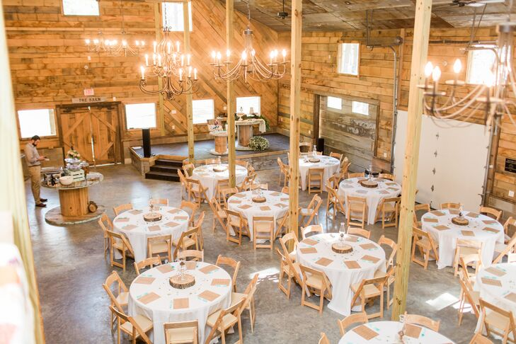 """It was so neat—lots of old wood and galvanized metal. It was a very homey place,"" Karley says of the Barn at Sleepy Hollow in Clarksville, Arkansas, which hosted the couple's reception."
