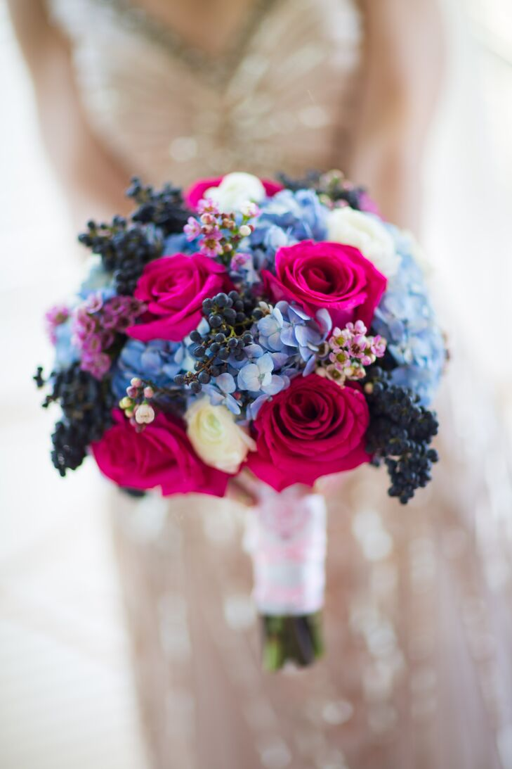 For an added element of texture, Galina and Andrew's florist  mixed dark blue berries into Galina's bright pink and blue bridal bouquet.