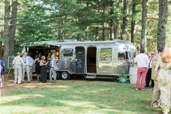 The couple's close friends renovated an Airstream trailer and repurposed it as a bar for cocktail hour, where an assortment of local beers, plus two signature cocktails—hibiscus fizz and sidecar—were served.