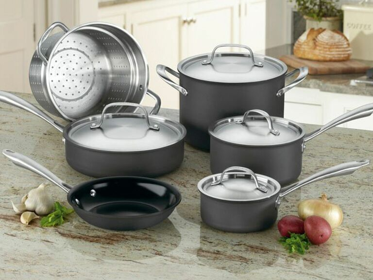 silver and gray Cuisinart cookware set sitting on counter