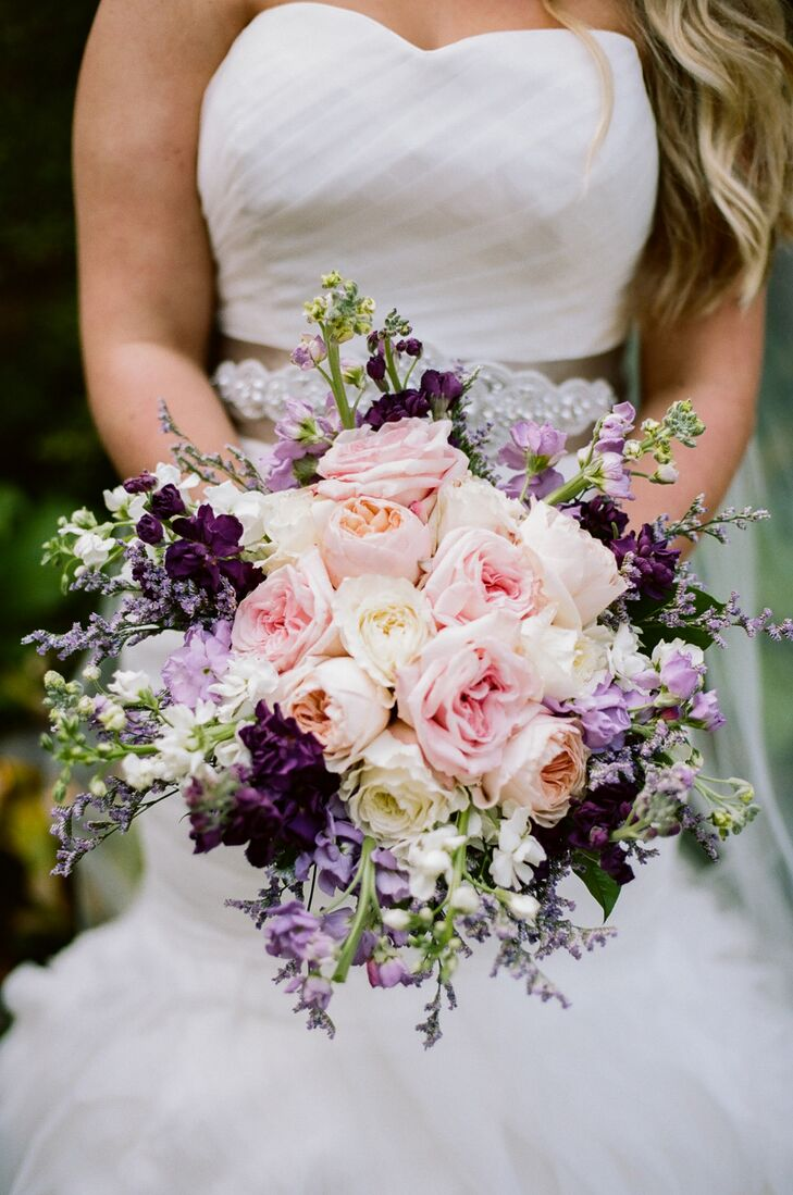 Ashley's bridal bouquet perfectly captured the feel of the wedding's romantic, garden setting. The elegant, cascading bouquet featured garden roses in soft pink hues, surrounded by a halo of stock and lavender in varying shades of purple, which together created plenty of textured, dramatic appeal.