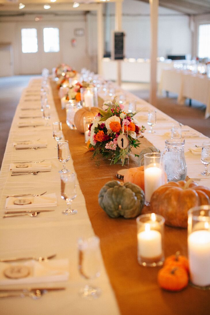 The farmhouse-style dining tables were covered with burlap runners and featured pumpkins and candles as decor.
