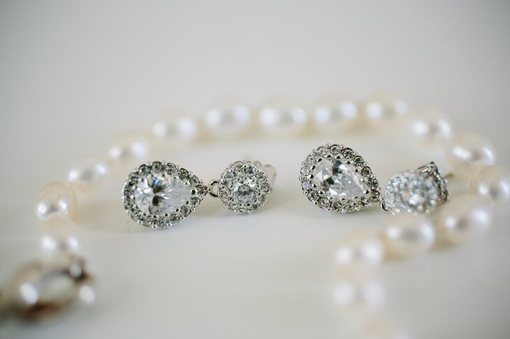 "The bride accessorized with simple crystal earrings. Kelsey's ""something borrowed"" was her mother's pearl bracelet."