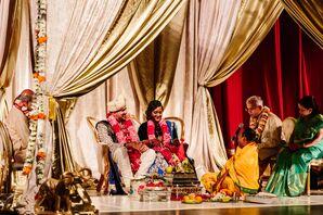 Indian Couple Under Gold Hindu Mandap