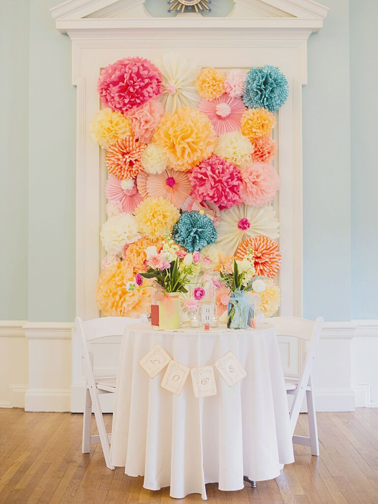 Colorful tissue paper sweetheart table backdrop