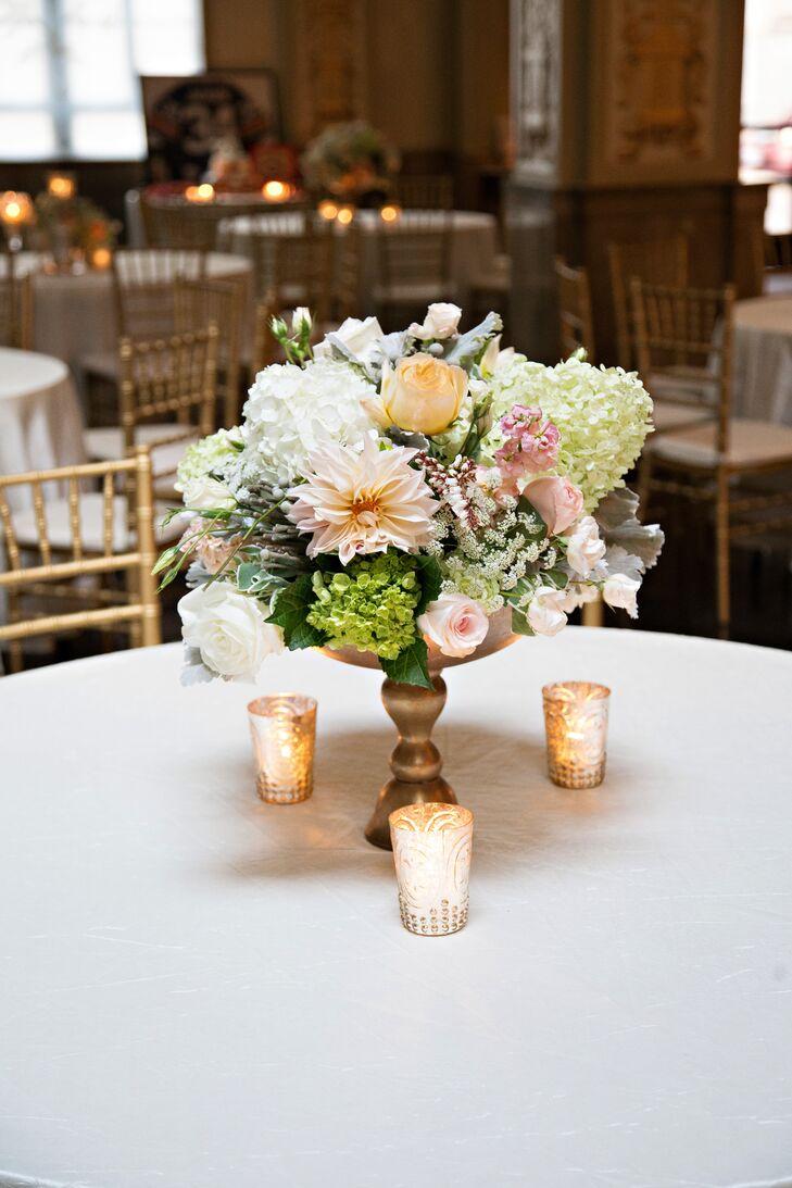 Elegant Pastel Centerpieces in Gilded Vases
