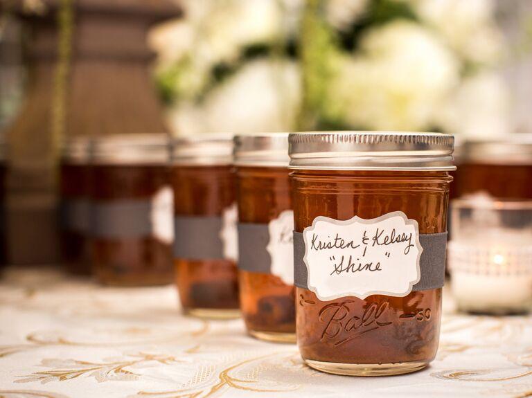 Homemade moonshine wedding favors in mason jars