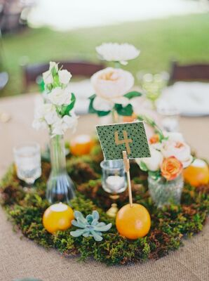 Orange Accented Table Numbers and Centerpieces