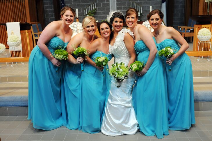 Bridesmaids wore floor-length strapless dresses in turquoise. Kim and her 'maids held lime green button mum bouquets with crystal accents.
