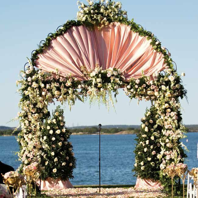 With the expansive bay as a backdrop, Amanda and Justin exchanged vows beneath a romantic gazebo draped in pink fabric, flowers and greenery.