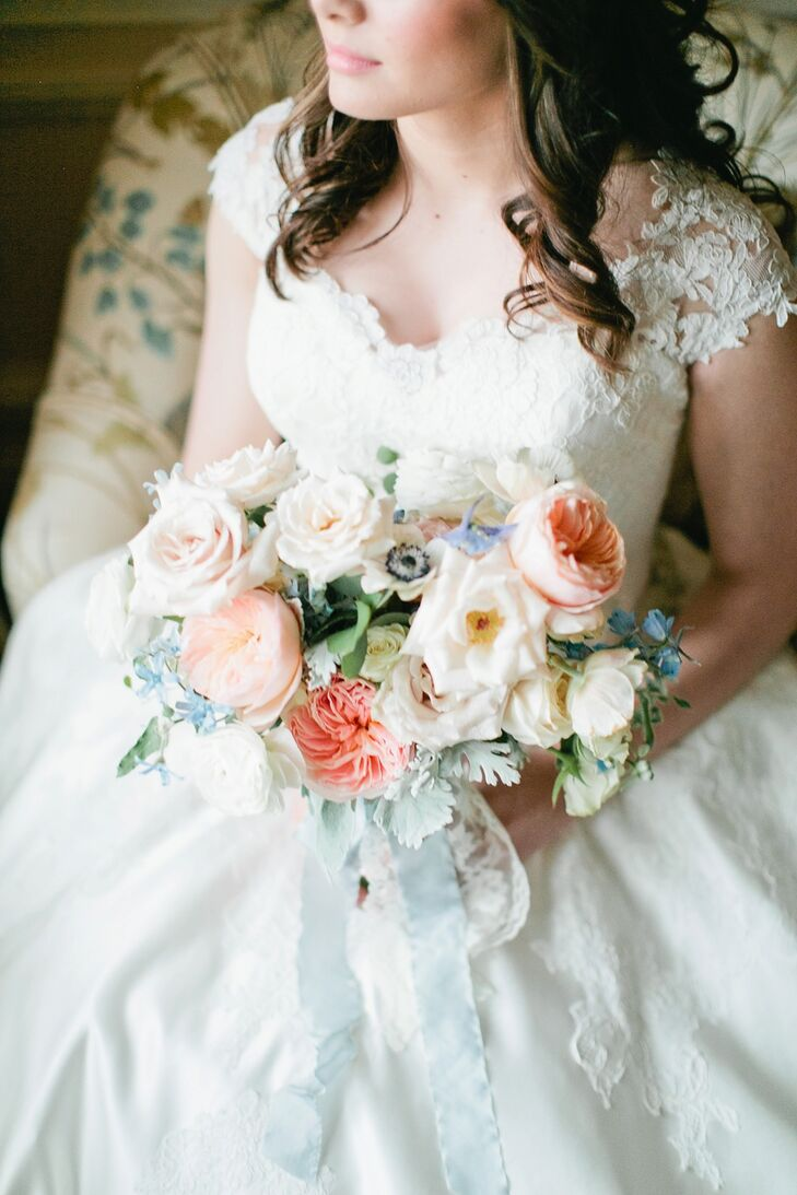 With a garden theme, flowers are a priority. Brittany's bouquet consisted of white and pink garden roses, pink peonies, baby's breath and alstroemerias, a type of lily.