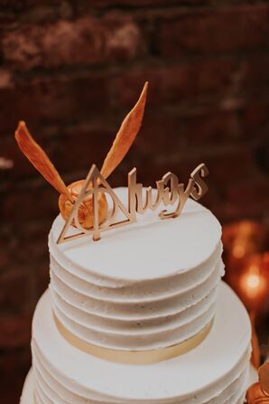 White Frosted Cake with Harry Potter Cake Topper
